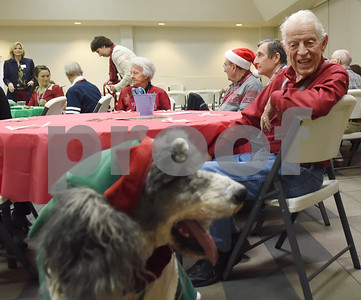 Bryan Ross is visited by a poodle dressed as Santa;s helper during the Alzheimer's Alliance's Wonderful Wednesdays program Wednesday Dec. 14, 2016. Wonderful Wednesdays is a day club program that provides cognitive and social stimulation for individuals in the early or mid-stages of Alzheimer's disease and related dementias. It also serves as a break time for families and caregivers.   (Sarah A. Miller/Tyler Morning Telegraph)