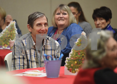 David LaRue smiles during the Alzheimer's Alliance's Wonderful Wednesdays program Wednesday Dec. 14, 2016. Wonderful Wednesdays is a day club program that provides cognitive and social stimulation for individuals in the early or mid-stages of Alzheimer's disease and related dementias. It also serves as a break time for families and caregivers.   (Sarah A. Miller/Tyler Morning Telegraph)