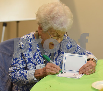 Mary Lynn Cleaver writes a Christmas card during the Alzheimer's Alliance's Wonderful Wednesdays program Wednesday Dec. 14, 2016. Wonderful Wednesdays is a day club program that provides cognitive and social stimulation for individuals in the early or mid-stages of Alzheimer's disease and related dementias. It also serves as a break time for families and caregivers.   (Sarah A. Miller/Tyler Morning Telegraph)