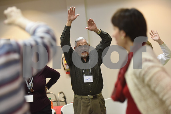 Larry Roberts stretches during the Alzheimer's Alliance's Wonderful Wednesdays program Wednesday Dec. 14, 2016. Wonderful Wednesdays is a day club program that provides cognitive and social stimulation for individuals in the early or mid-stages of Alzheimer's disease and related dementias. It also serves as a break time for families and caregivers.   (Sarah A. Miller/Tyler Morning Telegraph)