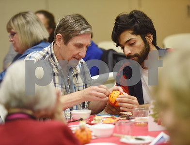 Farhan Chaudhry helps David LaRue make a craft during the Alzheimer's Alliance's Wonderful Wednesdays program Wednesday Dec. 14, 2016. Wonderful Wednesdays is a day club program that provides cognitive and social stimulation for individuals in the early or mid-stages of Alzheimer's disease and related dementias. It also serves as a break time for families and caregivers.   (Sarah A. Miller/Tyler Morning Telegraph)