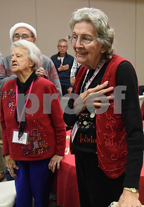 Glenna Lifesy, right, recites the Pledge of Allegiance during the Alzheimer's Alliance's Wonderful Wednesdays program Wednesday Dec. 14, 2016. Wonderful Wednesdays is a day club program that provides cognitive and social stimulation for individuals in the early or mid-stages of Alzheimer's disease and related dementias. It also serves as a break time for families and caregivers.   (Sarah A. Miller/Tyler Morning Telegraph)