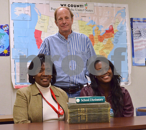 Lenore King, 46, and her daughter April, 18, recently received their GED certifications at the same time, thanks in part to their teacher Rich Roeper, of the Literacy Council of Tyler. (Victor Texcucano)