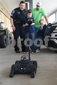 Sergeant Matt Leigeber shows Corbin Glasscock, 8, how to use a remote controlled robot at the downtown Tyler Police Department Tuesday Dec. 27, 2016. Also pictured is his father Josh and brother Jaxon, 5. Corbin Glasscock is a Make-A-Wish Foundation Wish Kid. A donor purchased the opportunity for Glasscock to be Police Chief for a Day.  (Sarah A. Miller/Tyler Morning Telegraph)