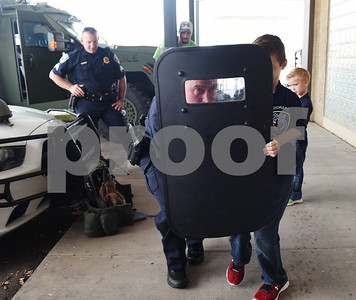 Sergeant Matt Leigeber shows Corbin Glasscock, 8, how to use a shield at the downtown Tyler Police Department Tuesday Dec. 27, 2016. Corbin Glasscock is a Make-A-Wish Foundation Wish Kid. A donor purchased the opportunity for Glasscock to be Police Chief for a Day.  (Sarah A. Miller/Tyler Morning Telegraph)