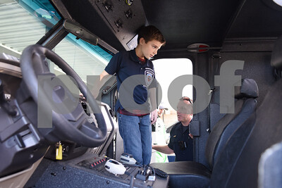 Corbin Glasscock, 8, takes a tour of an armored SWAT vehicle at the downtown Tyler Police Department Tuesday Dec. 27, 2016. Corbin Glasscock is a Make-A-Wish Foundation Wish Kid. A donor purchased the opportunity for Glasscock to be Police Chief for a Day.  (Sarah A. Miller/Tyler Morning Telegraph)