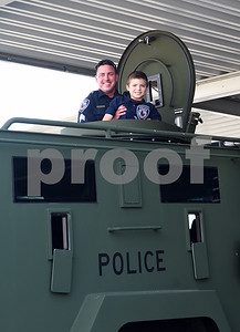 Sergeant Matt Leigeber lifts Corbin Glasscock, 8, out the top of an armored SWAT vehicle at the downtown Tyler Police Department Tuesday Dec. 27, 2016. Corbin Glasscock is a Make-A-Wish Foundation Wish Kid. A donor purchased the opportunity for Glasscock to be Police Chief for a Day.  (Sarah A. Miller/Tyler Morning Telegraph)