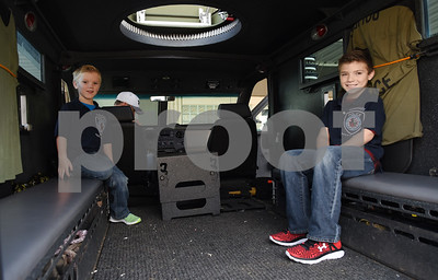 Brothers Jaxon Glasscock, 5, and Corbin Glasscock, 8, take a tour of an armored SWAT vehicle at the downtown Tyler Police Department Tuesday Dec. 27, 2016. Corbin Glasscock is a Make-A-Wish Foundation Wish Kid. A donor purchased the opportunity for Glasscock to be Police Chief for a Day.  (Sarah A. Miller/Tyler Morning Telegraph)