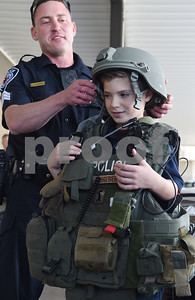 Sergeant Matt Leigeber puts a heavy vest and helmet on Corbin Glasscock, 8, how to use a shield at the downtown Tyler Police Department Tuesday Dec. 27, 2016. Corbin Glasscock is a Make-A-Wish Foundation Wish Kid. A donor purchased the opportunity for Glasscock to be Police Chief for a Day.  (Sarah A. Miller/Tyler Morning Telegraph)