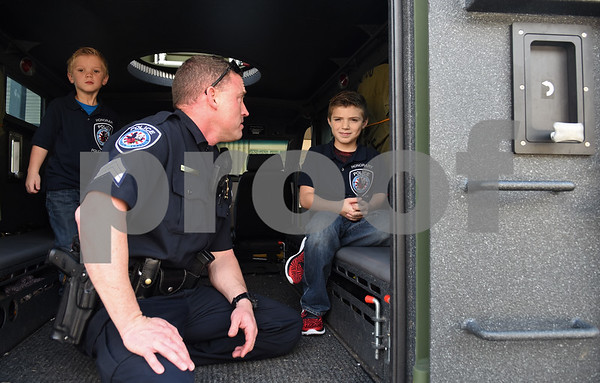 Sergeant Matt Leigeber gives Corbin Glasscock, 8, right, and his brother Jaxson, 5, a tour of an armored vehicle at the downtown Tyler Police Department Tuesday Dec. 27, 2016. Corbin Glasscock is a Make-A-Wish Foundation Wish Kid. A donor purchased the opportunity for Glasscock to be Police Chief for a Day.  (Sarah A. Miller/Tyler Morning Telegraph)