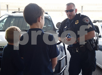 Sergeant David Hall talks to Jaxon Glasscock, 5, and Corbin Glasscock, 8, at the downtown Tyler Police Department Tuesday Dec. 27, 2016. Corbin Glasscock is a Make-A-Wish Foundation Wish Kid. A donor purchased the opportunity for Glasscock to be Police Chief for a Day.  (Sarah A. Miller/Tyler Morning Telegraph)