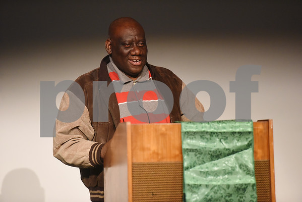 Gregory Buckner, president of the local African-American Cultural Events Committee, speaks during the Kwanzaa celebration at the Tyler Public Library Wednesday night Dec. 28, 2016.  (Sarah A. Miller/Tyler Morning Telegraph)