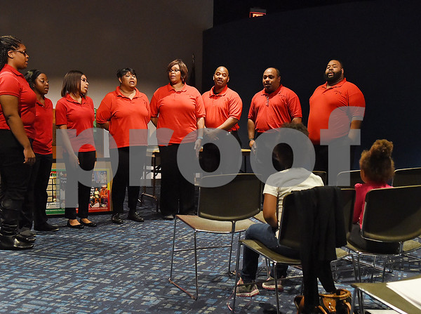 Faithful Praise performs during the Kwanzaa celebration held by the African-American Cultural Events Committee at the Tyler Public Library Wednesday night Dec. 28, 2016.  (Sarah A. Miller/Tyler Morning Telegraph)