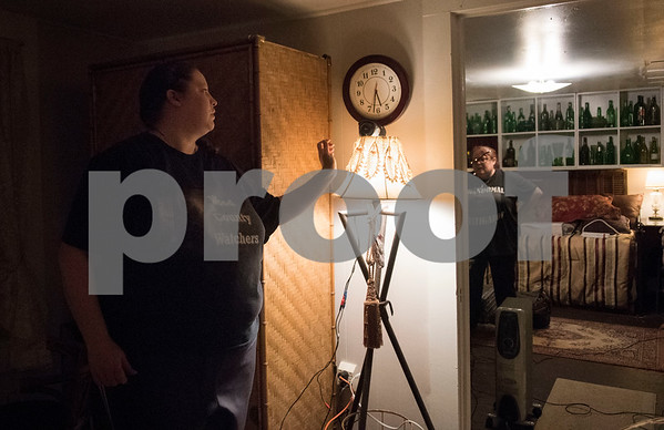 Rachel Pantusa sets up infrared cameras to capture footage and possible paranormal activity during an excursion with her paranormal group called Wood County Watchers at the historic O. P. Pyle House and related properties in Mineola on Dec. 9, 2017.   (Sarah A. Miller/Tyler Morning Telegraph)