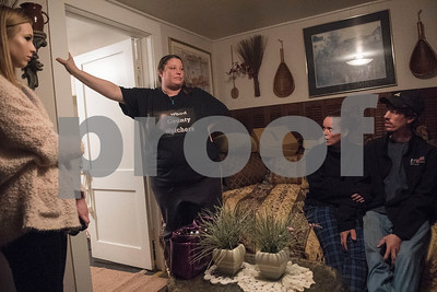 Rachel Pantusa talks to guests during an excursion with her paranormal group called Wood County Watchers at the historic O. P. Pyle House and related properties in Mineola on Dec. 9, 2017.   (Sarah A. Miller/Tyler Morning Telegraph)