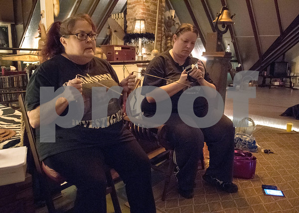 Dawn Trammell and her daughter Rachel Pantusa explain how to use various ghost detecting equipment during an excursion with their paranormal group called Wood County Watchers at the historic O. P. Pyle House and related properties in Mineola on Dec. 9, 2017.   (Sarah A. Miller/Tyler Morning Telegraph)