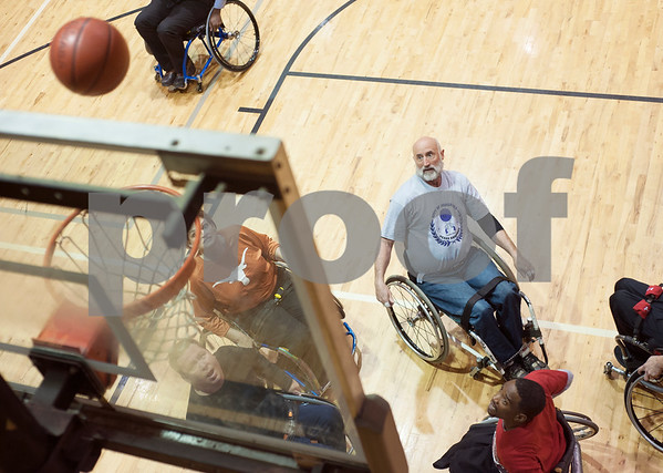 Dennis Poff of Tyler watches his ball as it nears the net during Tyler Thorns practice at First Christian Church in Tyler Tuesday Dec. 29, 2015. Tyler Thorns are a wheelchair basketball team that competes in Division III of the National Wheelchair Basketball Association.  (Sarah A. Miller/Tyler Morning Telegraph)