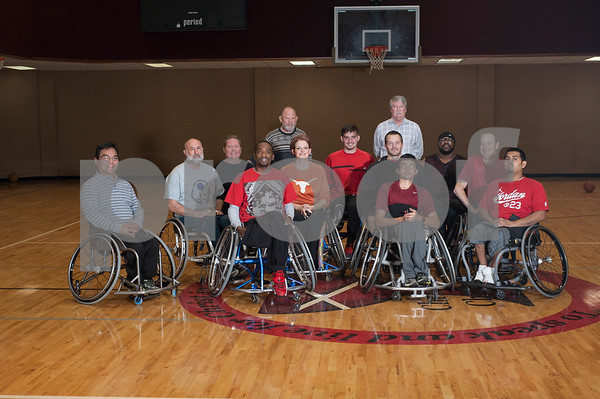First Christian Church representatives Dale Barton, left, and Wayne Aaron, right, are pictured with the Tyler Thorns wheelchair basketball team at First Christian Church in Tyler Tuesday Dec. 29, 2015. Tyler Thorns are a wheelchair basketball team that competes in Division III of the National Wheelchair Basketball Association.  (Sarah A. Miller/Tyler Morning Telegraph)