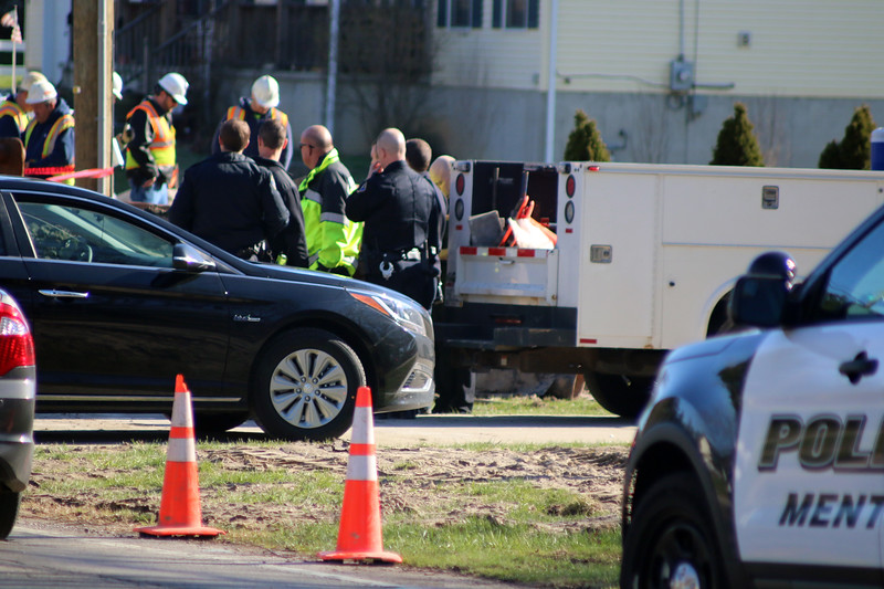 Investigators from Aqua Ohio, the Mentor fire and police departments, the Occupational Safety and Health Administration and other agencies investigate the scene of a fatal utility construction project on the west side of Heisley Road between Jackson Street and Mentor Avenue March 29. Authorities report a 28-year-old Aqua Ohio employee was killed when a trench collapsed on him. (News-Herald file)