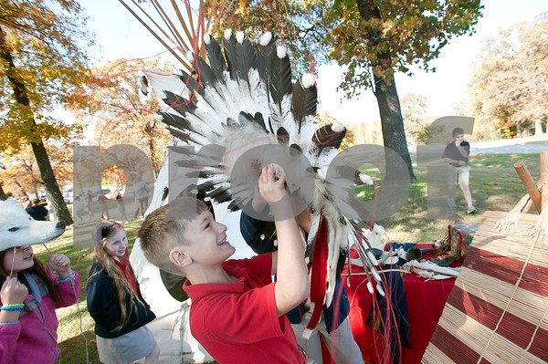 photo by Sarah A. Miller/Tyler Morning Telegraph  All Saints Episcopal School third grader Caleb Daily, 9, tries on a headdress after attending a presentation about Native American daily life held at the school Tuesday. The third graders at All Saints Episcopal School have been studying Native Americans and learning about the different regions in the U.S. and how those regions affect the lifestyle of the tribes. Tyler resident Cece Allen of Tejas Lodge, Order of the Arrow held a presentation with authentic tribal tools, weapons, clothing, a teepee, furs and games for the children from the Lakota Sioux Native American lifestyle.