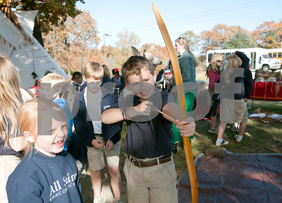 photo by Sarah A. Miller/Tyler Morning Telegraph  All Saints Episcopal School third grader Andrew Johnson, 9, plays with a bow and arrow after attending a presentation about Native American daily life held at the school Tuesday. The third graders at All Saints Episcopal School have been studying Native Americans and learning about the different regions in the U.S. and how those regions affect the lifestyle of the tribes. Tyler resident Cece Allen of Tejas Lodge, Order of the Arrow held a presentation with authentic tribal tools, weapons, clothing, a teepee, furs and games for the children from the Lakota Sioux Native American lifestyle.