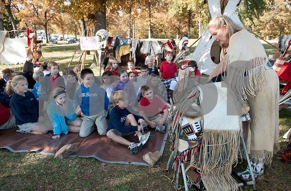 photo by Sarah A. Miller/Tyler Morning Telegraph  Tyler resident Cece Allen of Tejas Lodge, Order of the Arrow shows All Saints Episcopal School third graders a Lakota Sioux horse saddle during a presentation about Native American daily life held at the school Tuesday.