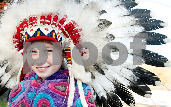 photo by Sarah A. Miller/Tyler Morning Telegraph  All Saints Episcopal School third grader Jenna Haggerton, 8, tries on a Lakota Sioux headdress after attending a presentation about Native American daily life held at the school Tuesday. The third graders at All Saints Episcopal School have been studying Native Americans and learning about the different regions in the U.S. and how those regions affect the lifestyle of the tribes. Tyler resident Cece Allen of Tejas Lodge, Order of the Arrow held a presentation with authentic tribal tools, weapons, clothing, a teepee, furs and games for the children from the Lakota Sioux Native American lifestyle.
