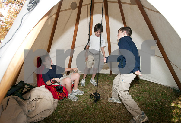 photo by Sarah A. Miller/Tyler Morning Telegraph  All Saints Episcopal School third graders Andrew Johnson, 9, Eli Saunders, 9, and Thomas Briggs, 9, play inside a teepee after attending a presentation about Native American daily life held at the school Tuesday. The third graders at All Saints Episcopal School have been studying Native Americans and learning about the different regions in the U.S. and how those regions affect the lifestyle of the tribes. Tyler resident Cece Allen of Tejas Lodge, Order of the Arrow held a presentation with authentic tribal tools, weapons, clothing, a teepee, furs and games for the children to experience a true Native American lifestyle.