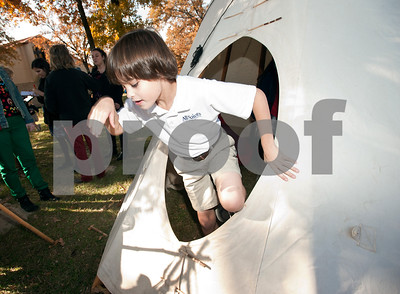 photo by Sarah A. Miller/Tyler Morning Telegraph  All Saints Episcopal School third grader Eli Saunders, 9, leaves a teepee he was playing in after attending a presentation about Native American daily life held at the school Tuesday. The third graders at All Saints Episcopal School have been studying Native Americans and learning about the different regions in the U.S. and how those regions affect the lifestyle of the tribes. Tyler resident Cece Allen of Tejas Lodge, Order of the Arrow held a presentation with authentic tribal tools, weapons, clothing, a teepee, furs and games for the children to experience a true Native American lifestyle.