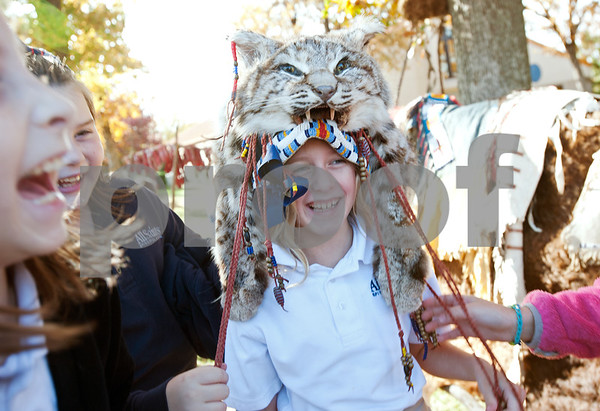 photo by Sarah A. Miller/Tyler Morning Telegraph  All Saints Episcopal School third grader Sophie Saunders, 9, tries on a headdress made from a bobcat after attending a presentation about Native American daily life held at the school Tuesday. The third graders at All Saints Episcopal School have been studying Native Americans and learning about the different regions in the U.S. and how those regions affect the lifestyle of the tribes. Tyler resident Cece Allen of Tejas Lodge, Order of the Arrow held a presentation with authentic tribal tools, weapons, clothing, a teepee, furs and games for the children from the Lakota Sioux Native American lifestyle.