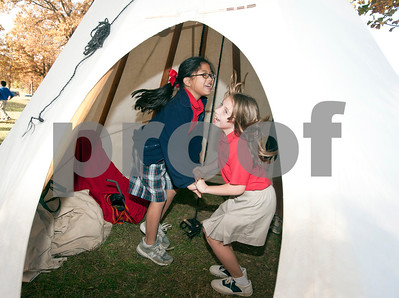 photo by Sarah A. Miller/Tyler Morning Telegraph  All Saints Episcopal School third graders Jacqueline Pamatmat, 8, and Isabella Egana, 8, dance inside a teepee after attending a presentation about Native American daily life held at the school Tuesday. The third graders at All Saints Episcopal School have been studying Native Americans and learning about the different regions in the U.S. and how those regions affect the lifestyle of the tribes. Tyler resident Cece Allen of Tejas Lodge, Order of the Arrow held a presentation with authentic tribal tools, weapons, clothing, a teepee, furs and games for the children from the Lakota Sioux Native American lifestyle.