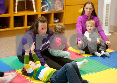 photo by Sarah A. Miller/Tyler Morning Telegraph  Sarah Smith, Kindermusik of Tyler teacher, left, teaches  her students the difference between high and low sounds  during Kindermusik class Friday Nov. 8 at First Presbyterian Church in Tyler. Kindermusik is an early childhood music and movement program.