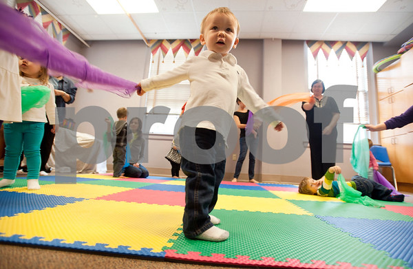 photo by Sarah A. Miller/Tyler Morning Telegraph  Garrett Porter of Tyler, 1, waves a purple scarf during  Kindermusik class Friday Nov. 8 at First Presbyterian Church in Tyler. Kindermusik is an early childhood music and movement program.