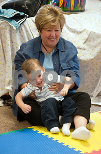 photo by Sarah A. Miller/Tyler Morning Telegraph  Diana Taylor of Tyler holds her grandson Ryan Taylor, 2, as he moves to the music during his Kindermusik class Friday Nov. 8 at First Presbyterian Church in Tyler. Kindermusik is an early childhood music and movement program.