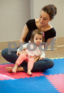 photo by Sarah A. Miller/Tyler Morning Telegraph  Thiana Douglas of Flint holds her daughter Marcela Douglas, 1, as they sway side to side to the music during  Kindermusik class Friday Nov. 8 at First Presbyterian Church in Tyler. Kindermusik is an early childhood music and movement program.