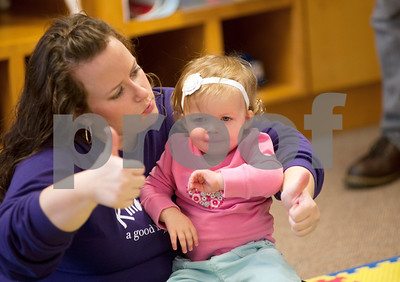 photo by Sarah A. Miller/Tyler Morning Telegraph  Sarah Smith, Kindermusik of Tyler teacher, left, sings a song called Tommy Thumbs while holding her daughter Reagan during Kindermusik class Friday Nov. 8 at First Presbyterian Church in Tyler. Kindermusik is an early childhood music and movement program.