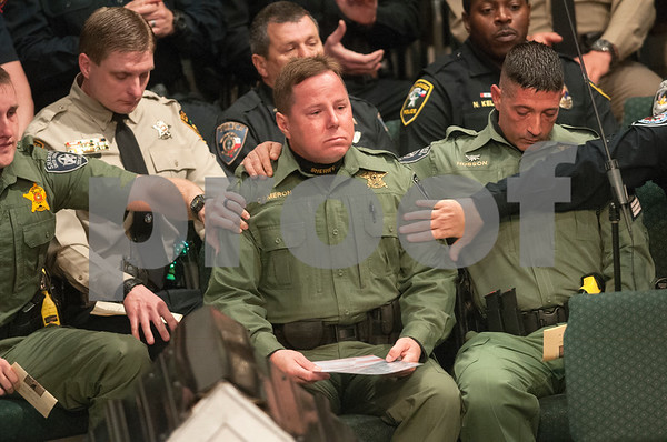 Smith County Sheriff's Office Deputy Corey Cameron is comforted by fellow officers after reading a poem about K-9 officers during the memorial service for Smith County Precinct 5 K-9 officer Ogar Saturday Jan. 23, 2016 held at First Baptist Church in Lindale, Texas. K-9 officer Ogar was slain while chasing a suspect after a traffic stop Tuesday Jan. 19. Ogar had been with Constable Kevin Petty for a little more than a year.   (Sarah A. Miller/Tyler Morning Telegraph)