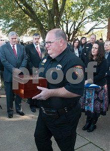 Smith County Constable Kevin Petty carries the ashes of his K-9 partner Ogar to his patrol car at the conclusion of the memorial service for Ogar Saturday Jan. 23, 2016 held at First Baptist Church in Lindale, Texas. K-9 officer Ogar was slain while chasing a suspect after a traffic stop Tuesday Jan. 19. Ogar had been with Smith County Constable Kevin Petty for a little more than a year.   (Sarah A. Miller/Tyler Morning Telegraph)