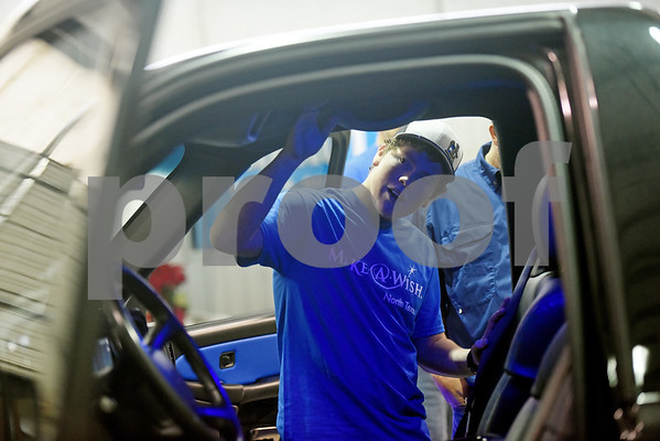 Nickolas Hill, 17, of Crandall looks at his revamped Chevy pickup truck after a surprise reveal of the truck at Davis-Green Paint and Body Shop in Tyler Tuesday Dec. 6, 2016. The truck was customized through the Make-A-Wish, which is an organization that grants wishes to children with life-threatening medical conditions to enhance the human experience with hope, strength and joy.   (Sarah A. Miller/Tyler Morning Telegraph)