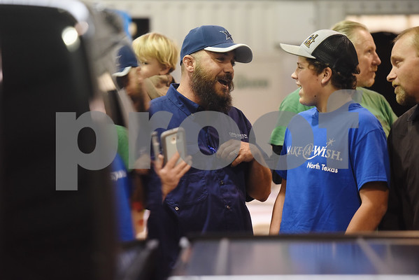Nickolas Hill, 17, of Crandall, talks with production manager Nathan Shirley after receiving his revamped Chevy pickup truck in a surprise reveal of the truck at Davis-Green Paint and Body Shop in Tyler Tuesday Dec. 6, 2016. The truck was customized through the Make-A-Wish, which is an organization that grants wishes to children with life-threatening medical conditions to enhance the human experience with hope, strength and joy.   (Sarah A. Miller/Tyler Morning Telegraph)