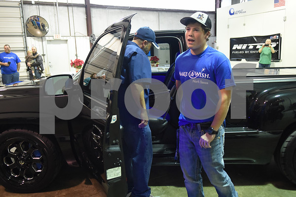 Nickolas Hill, 17, of Crandall thanks the crowd for his revamped Chevy pickup truck after a surprise reveal of the truck at Davis-Green Paint and Body Shop in Tyler Tuesday Dec. 6, 2016. The truck was customized through the Make-A-Wish, which is an organization that grants wishes to children with life-threatening medical conditions to enhance the human experience with hope, strength and joy.   (Sarah A. Miller/Tyler Morning Telegraph)