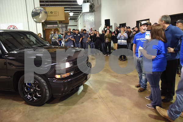 Nickolas Hill, 17, of Crandall receives his revamped Chevy pickup truck in a surprise reveal of the truck at Davis-Green Paint and Body Shop in Tyler Tuesday Dec. 6, 2016. The truck was customized through the Make-A-Wish, which is an organization that grants wishes to children with life-threatening medical conditions to enhance the human experience with hope, strength and joy.   (Sarah A. Miller/Tyler Morning Telegraph)
