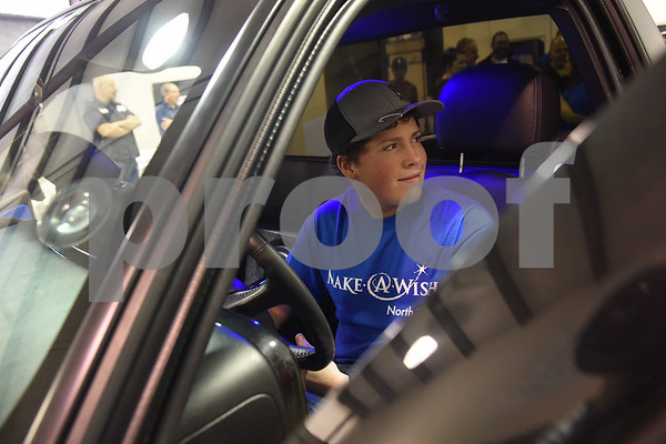 Nickolas Hill, 17, of Crandall sits in his revamped Chevy pickup truck after a surprise reveal of the truck at Davis-Green Paint and Body Shop in Tyler Tuesday Dec. 6, 2016. The truck was customized through the Make-A-Wish, which is an organization that grants wishes to children with life-threatening medical conditions to enhance the human experience with hope, strength and joy.   (Sarah A. Miller/Tyler Morning Telegraph)