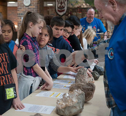 Students from Grand Saline Intermediate School touch large rocks at the East Texas Gem and Mineral Society's 22nd annual jewelry, rock, mineral and fossil show at the Tyler Rose Garden Center on January 26, 2018. The show continues through Jan. 28.  (Sarah A. Miller/Tyler Morning Telegraph)