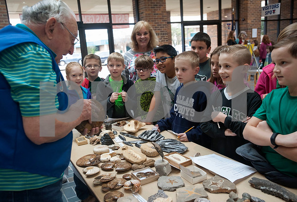 Students from Canton Intermediate School listen to a presentation on fossils from Gene Gore at the East Texas Gem and Mineral Society's 22nd annual jewelry, rock, mineral and fossil show at the Tyler Rose Garden Center on January 26, 2018. The show continues through Jan. 28.  (Sarah A. Miller/Tyler Morning Telegraph)