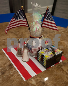 Patriotic centerpieces decorate the tables at The Hamptons Retirement Community for the free first responder appreciation breakfast event on Friday Jan. 26, 2018.  (Sarah A. Miller/Tyler Morning Telegraph)