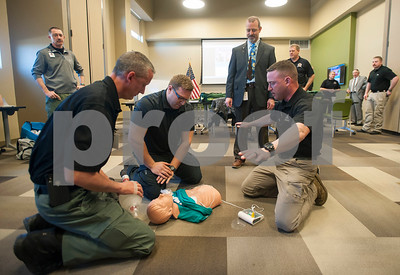 Tyler Police Department members Sergeant Adam Tarrant, officer Josh Darty and Sergeant Matt Leigeber take an Emergency Medical Responder (EMR) certification program held on Tuesday Jan. 23, 2018 at South Faulkner Police Station, 574 W. Cumberland Road. The partnership between the Tyler Police Department and East Texas Medical Center trains police officers to provide the initial lifesaving care for patients experiencing emergencies such as cardiac arrest, overdose and traumatic injury.    (Sarah A. Miller/Tyler Morning Telegraph)