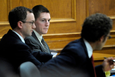Kevin McGregor (middle) sits with his lawyers, John Gifford (left) and Eric Zale (right) during the second day of his trial at the Boulder County Justice Center in Boulder, Colorado January 27, 2012.  McGregor is charged with the murder of Todd Walker in March of 2011. CAMERA/MARK LEFFINGWELL