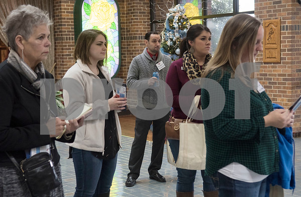 """Business leaders visit the Tyler Rose Museum during a tour of Tyler during the """"Keepin' Tyler Rosy"""" Destination Training held by the Tyler Chamber of Commerce on Thursday Dec. 7, 2017. The program is a training event designed to educate front line staff from local businesses on what Tyler has to offer to their clients and visitors as well as customer service training.  (Sarah A. Miller/Tyler Morning Telegraph)"""