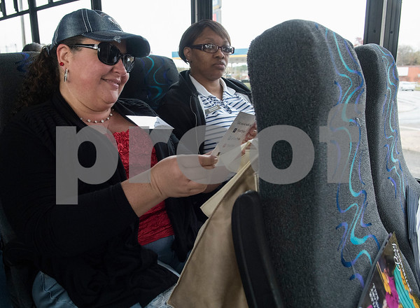 "Steff Lloyd of Stumpy Cider Co. and Sherrica Ervin of Homewood Suites Tyler take a bus tour of downtown Tyler during the ""Keepin' Tyler Rosy"" Destination Training held by the Tyler Chamber of Commerce on Thursday Dec. 7, 2017. The program is a training event designed to educate front line staff from local businesses on what Tyler has to offer to their clients and visitors as well as customer service training.  (Sarah A. Miller/Tyler Morning Telegraph)"